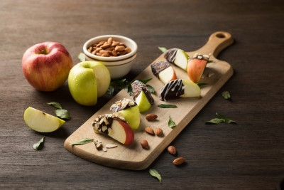 cheese board with almonds and snacks